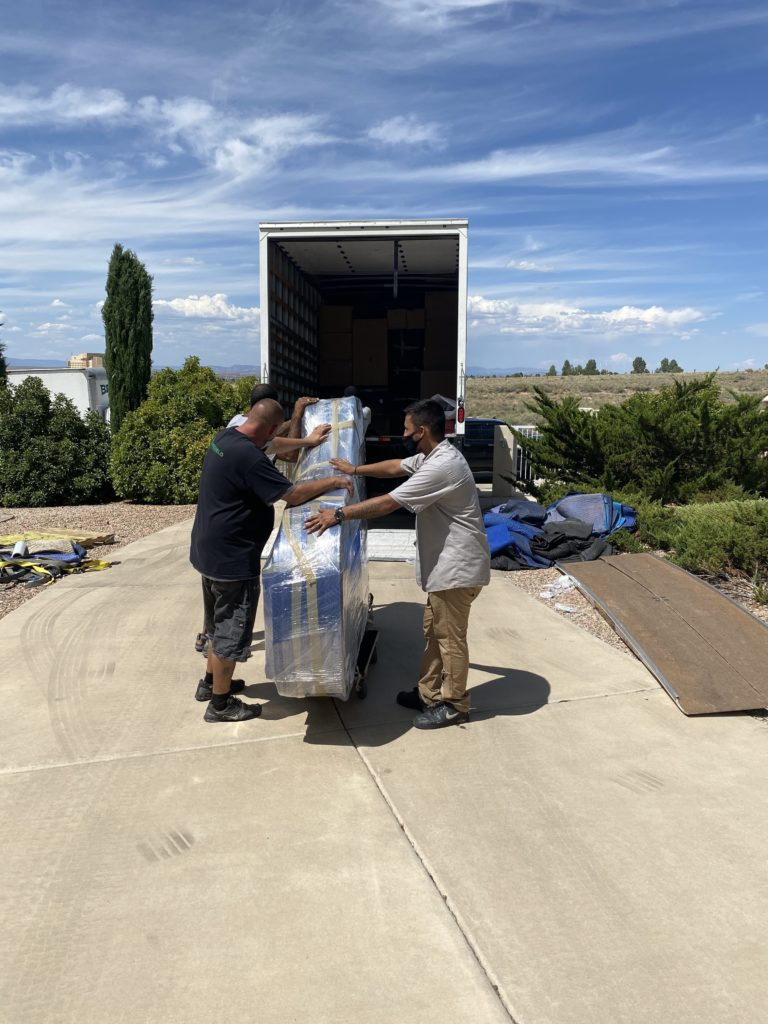 Grand piano moving safely into new home